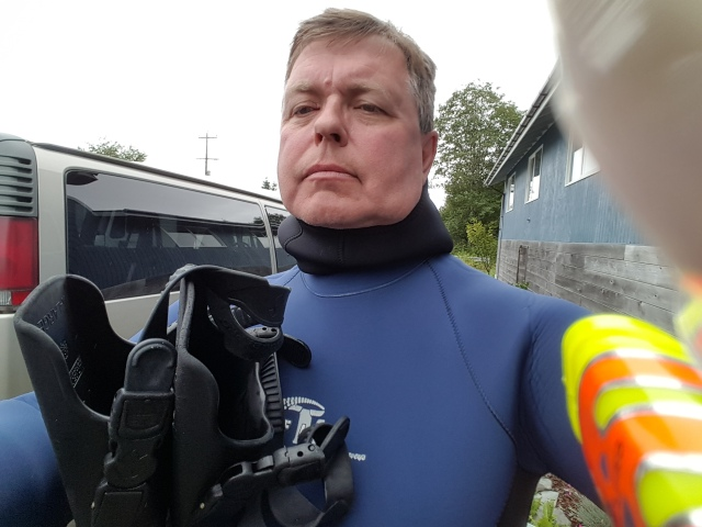 Tom is squeezed into a wet suit.
