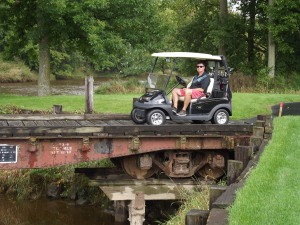 Tom is sitting a bridge that was the bed of an old train car. How creative!