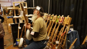 Here is one guy who creates guitars out of cigar boxes, bed pans, and cookie tins!
